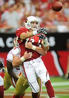 Sept. 13, 2009; Glendale, AZ, USA; Arizona Cardinals quarterback (13) Kurt Warner throws a pass under pressure from the San Francisco 49ers in the first quarter at University of Phoenix Stadium. Mandatory Credit: Mark J. Rebilas-