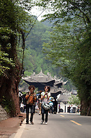 May 3rd, 2011_Shangri-La, Yunnan, China_ Tourists visit the Qingcheng Lianghe Mountain Village area in Sichuan Province, China.  Qingcheng is located near Chengdu and is an example of recent trends in China's tourism industry.  Photographer: Daniel J. Groshong/The Hummingfish Foundation