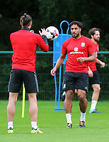 (L-R) Gareth Bale and Ashley Williams in action during the Wales Training Session at the Vale Resort, Hensol, Wales, UK. Tuesday 29 August 2017