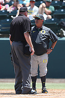 Oregon Ducks Head Coach George Horton #8 talks with umpire Scott Higgins during a game against the UCLA Bruins at Jackie Robinson Stadium on May 18, 2014 in Los Angeles, California. Oregon defeated UCLA, 5-4. (Larry Goren/Four Seam Images)