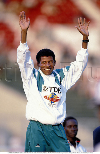 HAILE GEBRSELASSIE (ETH) celebrates his win in the Men's 10,000m at the World Athletics Championships, Stuttgart, 93. Photo: Glyn Kirk/Action Plus...1993 mens man athletics athlete winner winners wins.celebrate celebration celebrating.distance running runner ..