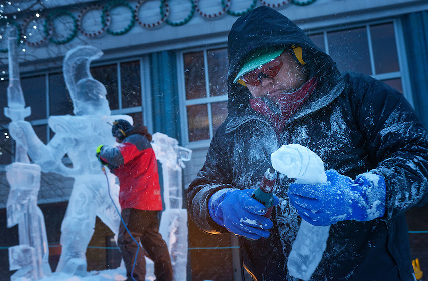 Mark Chapin, foreground, and Keven Laughlin, background, work on their sculpture of a Warhammer character on the final morning of the 2016 Crystal Gallery of Ice Ice Carving Competition in town square.