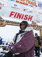 Bob Bundtzen poses at the finish line in Nome on Friday March 14 during the 2014 Iditarod Sled Dog Race.<br /> <br /> PHOTO (c) BY JEFF SCHULTZ/IditarodPhotos.com -- REPRODUCTION PROHIBITED WITHOUT PERMISSION