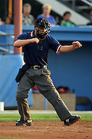 August 23 2008:  Home plate umpire Chris Nguyen during a game at Dwyer Stadium in Batavia, NY.  Photo by:  Mike Janes/Four Seam Images