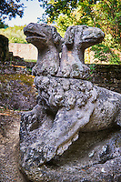 Statue of Cabero the trhree haeded guardian of the underworld, commissioned by Piaer Francesco Orsini c. 1513-84, The Renaissance Mannerist statues of the Park of Monsters or The Sacred Wood of Bamarzo, Italy