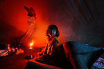 A Bangladeshi Buddhist child who lost her home in an overnight weekend attack sits in a tent in Ramu in the coastal district of Cox's Bazar, Bangladesh.