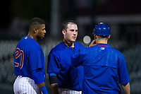AZL Cubs coach Ben Carhart talks to center fielder Nelson Velazquez (20) and catcher Marcus Mastrobuoni (5) laughs during a game against the AZL Angels on August 31, 2017 at Sloan Park in Mesa, Arizona. AZL Cubs defeated the AZL Angels 9-2. (Zachary Lucy/Four Seam Images)