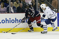 20 October 2006: Columbus Blue Jackets' Anson Carter, left, plays against Toronto Maple Leafs' Hal Gill at Nationwide Arena in Columbus, Ohio.<br />