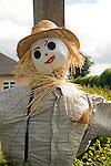 Scarecrow to advertise village garden open day event, Sutton, Suffolk, England