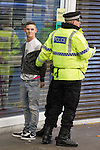 © Joel Goodman - 07973 332324 . 13/05/2013 . Manchester , UK . Police detain a man in handcuffs opposite the City Store after police and fans scuffled when police attempted to push Manchester United fans up Market Street , away from the City Store . Police confront 100s of Manchester United fans outside the Manchester City store on Market Street after the Manchester United victory parade , this evening (13th May 2013) Photo credit : Joel Goodman