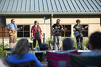 NWA Democrat-Gazette/FLIP PUTTHOFF <br /> SHELTER FOR LEARNING<br /> National Park Radio plays Saturday June 10 2017 during an unveiling of the design for a new  education pavilion to be built near the visitor center at Hobbs State Park-Conservation Area. Friends of Hobbs hosted a gala Saturday evening to unveil the design of the pavilion that will serve as an outdoor classroom and a covered outdoor venue for park events. Construction will begin this summer, said Rich Brya, board member with Friends of Hobbs. The $500,000 project is funded by Friends of Hobbs with a matching grant from Arkansas State Parks, Brya said. Location of the pavilion is in the picnic area just east of the visitor center.The event featured the National Park Radio performace, food, and prize drawings.