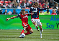 02 April 2011: Chivas USA forward Justin Braun #17 and Toronto FC defender Adrian Cann #12 in action during an MLS game between Chivas USA and the Toronto FC at BMO Field in Toronto, Ontario Canada..The game ended in a 1-1 draw.