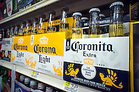 Bottles of imported from Mexico Corona beer are in seen a supermarket in New York on Monday, June 25, 2012. Anheuser-Busch InBev, maker of Budweiser is in talks to purchase the 50% stake that it doesn't already own in Grupo Modelo, maker of Corona. (© Richard B. Levine)