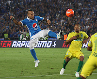 BOGOTA -COLOMBIA, 7-06-2017. Juan G. Dominguez player of Millonarios fights the ball  agaisnt of  Macnelly Torres player of Atletico Nacional .Action game between  Millonarios  and Atletico Nacional during match for quarter finals of the Aguila League I 2017 played at Nemesio Camacho El Campin stadium . Photo:VizzorImage / Felipe Caicedo  / Staff
