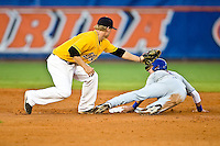 June 07, 2009:  NCAA Super Regional: Southern Miss Golden Eagles vs Florida Gators:    Florida Avery Barnes (1) escapes tag of Southern Miss 2B James Ewing during game two of Super Regional action at Alfred A. McKethan Stadium on the campus of University of Florida in Gainesville.  Southern Miss came from behind to defeat Florida 7-6 and to advance to the College World Series.   ...........