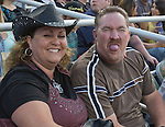 Rebecca Gill, with birthday boy Sean, as he sticks his tongue out at the camera during the Reno Rodeo on Saturday, June 20, 2015.
