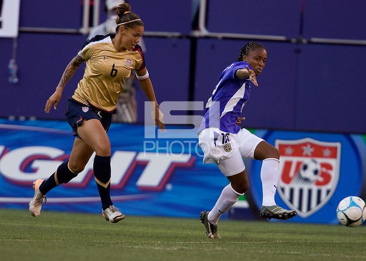 Natasha Kai watches Ester make a pass. USA defeated Brazil 2-0 at Giants Stadium on Sunday, June 23, 2007.