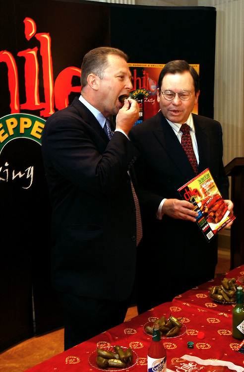 """chile1/042402 -- Max Sandlin, D-Texas, eats number eight to win the  uncontested chile pepper contest for the title of """"Zestiest Legislator"""". The contest was sponsored by Chile Pepper Magazine. Rep. Kay Granger, R-Texas; Rep. Ken Bentsen, D-Texas; Sen. Mary Landrieu, D-La.; Rep. Jeff Flake, R-Ariz.; Rep. Nick Lampson, D-Texas; Rep. Jerry Lewis, R-Calif.; Rep. Ed Pastor, D-Ariz.;  and Rep. Joe Skeen,  R-N.M. were all no shows."""