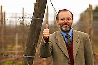 Juan Luis Bouza, owner in front of one of his Tannat vineyards. giving the thumbs up sign. Bodega Bouza Winery, Canelones, Montevideo, Uruguay, South America