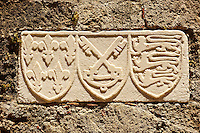 Heraldic Symbols on a lodge in the Avenue of the Knights. Left the Plantagenet Heraldic seal, centre of he cross keys of the Papal seal, right are the 3 lions of the Great Seal of King John 1 of England used from 11981340,  Rhodes, Greece, UNESCO World Heritage Site