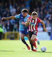 Lincoln City's Tyler Walker battles with Wycombe Wanderers' Darius Charles<br /> <br /> Photographer Andrew Vaughan/CameraSport<br /> <br /> The EFL Sky Bet League One - Wycombe Wanderers v Lincoln City - Saturday 7th September 2019 - Adams Park - Wycombe<br /> <br /> World Copyright © 2019 CameraSport. All rights reserved. 43 Linden Ave. Countesthorpe. Leicester. England. LE8 5PG - Tel: +44 (0) 116 277 4147 - admin@camerasport.com - www.camerasport.com