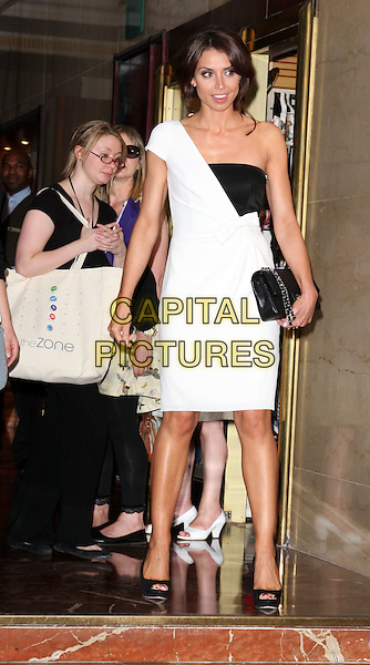 CHRISTINE BLEAKLEY.British Academy Television Craft Awards at the Hilton, Park Lane, London, England, UK, May 23rd 2010.BAFTA full length dress black white one shoulder walking peep toe shoes bow clutch bag .CAP/ROS.©Steve Ross/Capital Pictures