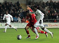 ATTENTION SPORTS PICTURE DESK<br /> Pictured: Marvin Emnes of Swansea (R) challenged by Liam Fontaine of Bristol (L)<br /> Re: npower Championship, Swansea City FC v Bristol City Football Club at the Liberty Stadium, south Wales. Wednesday 10 November 2010