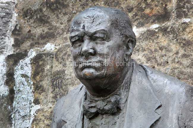 Bust of Sir Winston Churchill, 1874-1965, British politician and prime minister, by Frantisek Belsky, Czech sculptor, next to the British Embassy in Thunovska Street, Lesser quarter or Mala Strana, Prague, Czech Republic. The bronze bust was inaugurated in 1992 with Czechoslovak soldiers holding a guard of honour. The historic centre of Prague was declared a UNESCO World Heritage Site in 1992. Picture by Manuel Cohen