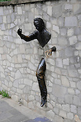 "Montmartre sculpture dedicated to Marcel Ayme, author of ""Le Passe-Muraille"""