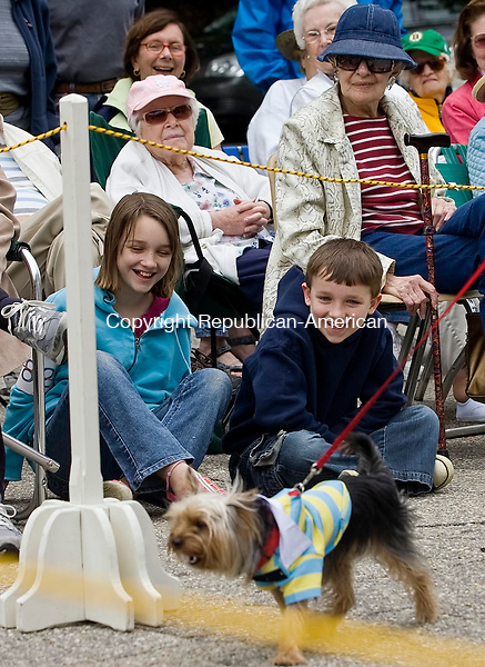 SOUTHBURY--24 May 08--052408TJ05 - Irene Reichl, 10, left, and her brother, Charlie, 8, from Danbury, react as Diane Churchill's yorkshire terrier, Rocky, passes by during the Heritage Village dog show on Saturday, May 24, 2008. (T.J. Kirkpatrick/Republican-American)