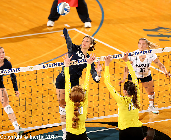 BROOKINGS, SD - SEPTEMBER 1: Abby Akin #9 from Northern Arizona looks to get a kill past Allison Ketcham #10 and Taylor Graboski #12 from Valparaiso during their match Friday afternoon at the Jackrabbit Invitational at Frost Arena in Brookings. (Photo by Dave Eggen/Inertia)