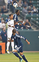 CARSON, CA – May 14, 2011: LA Galaxy defender AJ DeLaGarza and Sporting KC forward Kei Kamara go high to head the ball during the match between LA Galaxy and Sporting Kansas City at the Home Depot Center in Carson, California. Final score LA Galaxy 4, Sporting Kansas City 1.