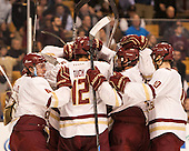 The Eagles celebrate their win. - The Boston College Eagles defeated the Harvard University Crimson 3-2 in the opening round of the Beanpot on Monday, February 1, 2016, at TD Garden in Boston, Massachusetts.