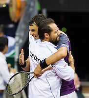 September 12, 2014, Netherlands, Amsterdam, Ziggo Dome, Davis Cup Netherlands-Croatia, Mate Delic (CRO) jubilates his win over Sijsling, and fold in the arms of his captain, he puts Croatia in a 1-0 lead.<br /> Photo: Tennisimages/Henk Koster