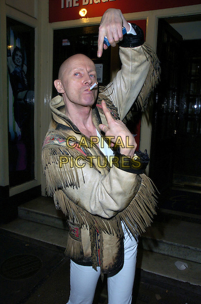 "RICHARD O'BRIEN.""The Rocky Horror Show"" press night, Comedy Theatre, London, UK..January 4th, 2007.half length brown beige leather tassel jacket pink detail smoking pointing gesture funny cigarette.CAP/CAN.©Can Nguyen/Capital Pictures"