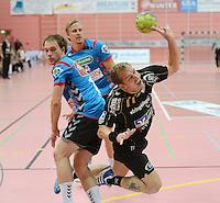 Handball 1. Bundesliga  2012/2013  in der Paul Horn Arena Tuebingen 08.09.2012 TV Neuhausen - TSV Hannover-Burgdorf Ralf Bader (re, TV Neuhausen) mit Ball gegen Lars Lehnhoff (TSV Hannover)