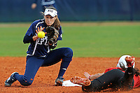 11 February 2012:  FIU's Kayla Burri (7) attempts to pull in the ball during a steal attempt as the University of Louisville Cardinals defeated the FIU Golden Panthers, 4-2, as part of the COMBAT Classic at the FIU Softball Complex in Miami, Florida.