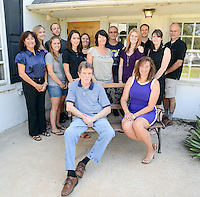 The staff at Big Brothers Big Sisters pose for a photo Tuesday August 25, 2015 in Jamison, Pennsylvania. (Photo by William Thomas Cain)