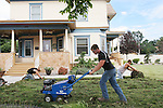 CHAD PILSTER &bull;&nbsp;Hays Daily News<br /> <br /> (left to right) Gage Younger, left and Jordan Moore, right, roll up fescue grass while Travis Pfannenstiel, all with the Riedel Garden Center, uses a sod cutter to loosen up the grass on Thursday, July 25, 2013, at the home of John Bird in Hays, Kansas. Bird is replacing fescue grass with bermuda. Darran Riedel, the owner of Riedel Garden Center, said that this is the 7th fescue grass they've replaced with either buffalograss or Bermudagrass. The garden center has sold more buffalograss seed this year than the last 5 years combined.