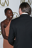 BEVERLY HILLS, CA - JANUARY 19: Lupita Nyong'o, Leonardo DiCaprio at the 25th Annual Producers Guild Awards held at The Beverly Hilton Hotel on January 19, 2014 in Beverly Hills, California. (Photo by Xavier Collin/Celebrity Monitor)