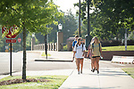 Rising juniors and twin sisters Laura Leigh, left, and Olivia Woodward head to their organic chemistry class on a Monday morning.  Photo by Kevin Bain/University Communications Photography.