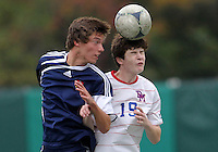 HYATTSVILLE, MD - OCTOBER 26, 2012:  Thomas Madden (19) of DeMatha Catholic High School goes for a header against Nick Notaro (12) of St. Albans during a match at Heurich Field in Hyattsville, MD. on October 26. DeMatha won 2-0.