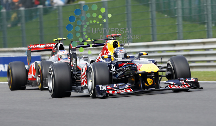 Formel 1 2011,11.Lauf Spa-Francorchamps,26.08.-28.08.11 .Sebastian Vettel (GER#1) Red Bull Racing, Jenson Button (GBR#4) Vodafone McLaren Mercedes..Picture:Hasan Bratic/Universal News And Sport (Europe) 28/08/2011.