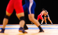 11 DEC 2011 - LONDON, GBR - Ashraf Aliyev (AZE) (in red) and Adam Sobieraj (POL) (in blue) wrestle for bronze during the men's 74kg bout at the London International Wrestling Invitational and 2012 Olympic Games test event at the ExCel Exhibition Centre in London, Great Britain (PHOTO (C) NIGEL FARROW)