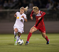 McCall Zerboni (7) of the Western NY Flash has the ball poked away from her by Lori Lindsey (6) of the Washington Spirit during the game at the Maryland SoccerPlex in Boyds, MD.  Washington tied Western NY, 1-1.