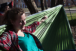 Alex Driehaus lays in a hammock with the Hammock Club outside of Morton Hall on Februrary 24, 2017.