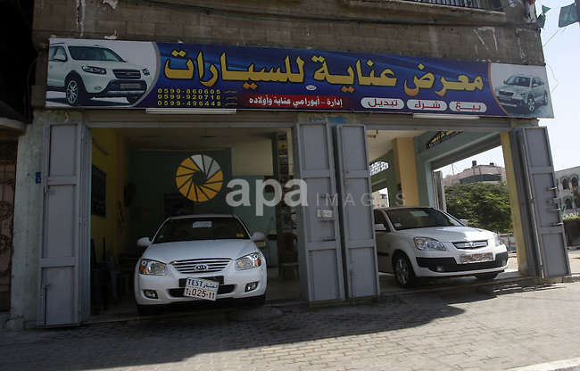 Cars are displayed at a showroom in Gaza City on Sep. 7, 2011. while Israel stop to enter cars into Gaza Strip again after it allowed to enter them as a part of a new strategy to increase Gaza blockade. Photo by Mahmud Nassar