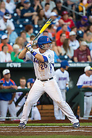 Peter Alonso (20) of the Florida Gators bats during a game between the Miami Hurricanes and Florida Gators at TD Ameritrade Park on June 13, 2015 in Omaha, Nebraska. (Brace Hemmelgarn/Four Seam Images)
