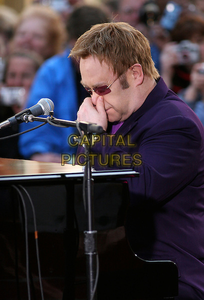 ELTON JOHN.Performs as a musical guest in the Today Show Concert Series this morning on NBC's Today Show, New York City, NY, USA..April 25th, 2006.Ref: IW.half length purple sunglasses shades touching rubbing nose music live.www.capitalpictures.com.sales@capitalpictures.com.©Capital Pictures