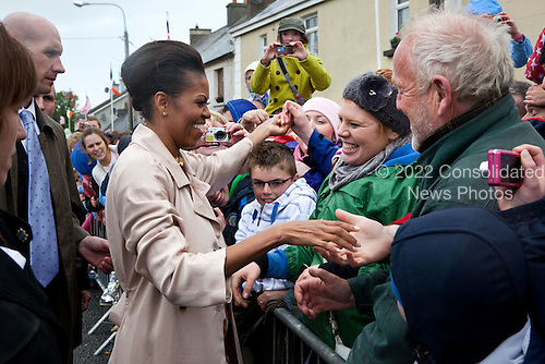 First Lady Michelle Obama greets people on Main Street in Moneygall, Ireland, May 23, 2011. .Mandatory Credit: Pete Souza - White House via CNP